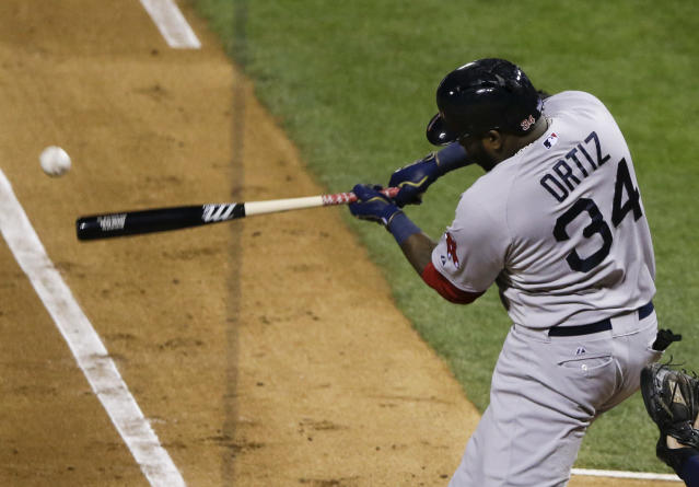 Boston Red Sox designated hitter David Ortiz singles off of St. Louis Cardinals starting pitcher Adam Wainwright during the fourth inning of Game 5 of baseball's World Series Monday, Oct. 28, 2013, in St. Louis. (AP Photo/Charlie Neibergall)