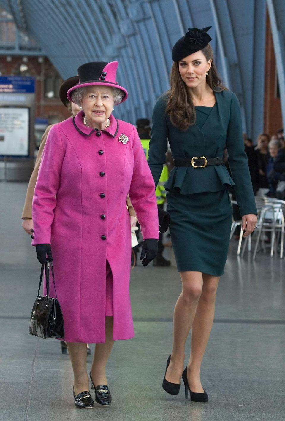<p>Kate joined Queen Elizabeth II for her first official engagement without Will during the Queen's Diamond Jubilee tour. Kate wore dark green separates from L.K. Bennett. Here she is at King's Cross St. Pancras Station in London. </p>
