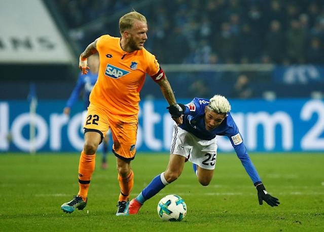 Soccer Football - Bundesliga - Schalke 04 vs TSG 1899 Hoffenheim - Veltins-Arena, Gelsenkirchen, Germany - February 17, 2018 Hoffenheim's Kevin Vogt in action with Schalke's Amine Harit REUTERS/Leon Kuegeler DFL RULES TO LIMIT THE ONLINE USAGE DURING MATCH TIME TO 15 PICTURES PER GAME. IMAGE SEQUENCES TO SIMULATE VIDEO IS NOT ALLOWED AT ANY TIME. FOR FURTHER QUERIES PLEASE CONTACT DFL DIRECTLY AT + 49 69 650050