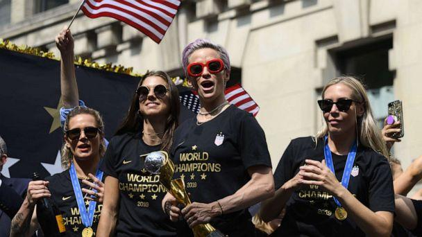 PHOTO: In this file photo taken on July 10, 2019, Megan Rapinoe, center, and other members of the World Cup-winning U.S. women's team take part in a ticker tape parade for the women's World Cup champions in New York. (Johannes Eisele/AFP/Getty Images, File)