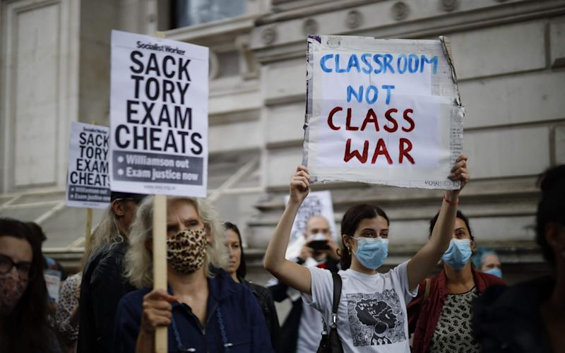 Around 100 protesters marched on Whitehall to demand a Government U-turn on exams - AFP