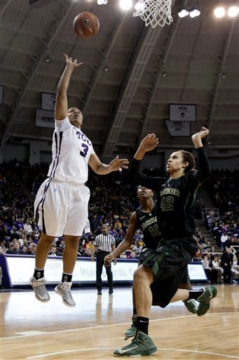 TCU's Veja Hamilton (3) shoots over Baylor center Brittney Griner (42) in the first half of an NCAA college basketball game, Wednesday, Jan. 2, 2013, in Fort Worth, Texas. (AP Photo/Tony Gutierrez)
