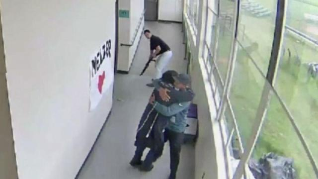Video shows Oregon coach disarming student then embracing him before police arrive (ABC News)