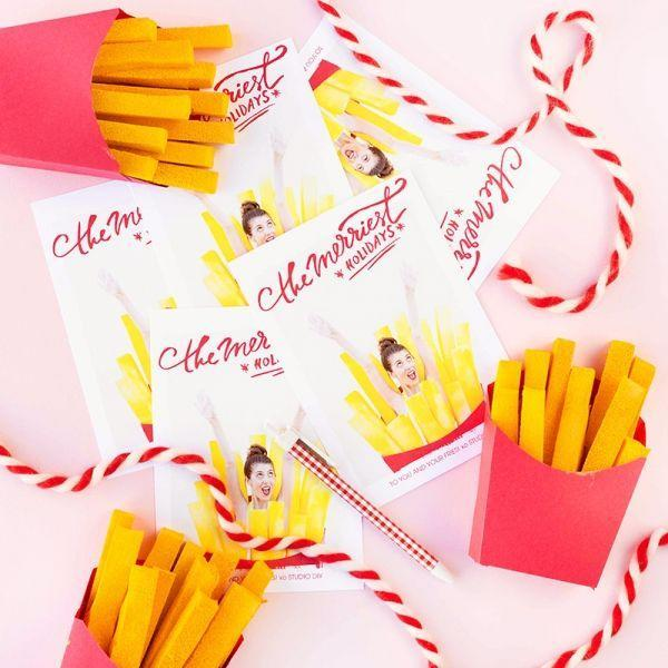 """<p>You love your friends and family <em>almost</em> as much as you love French fries. Let them know with this hilarious card. </p><p><strong>Get the tutorial at <a href=""""https://studiodiy.com/2015/12/23/merry-christmas-to-you-your-fries-and-a-happy-new-year/"""" rel=""""nofollow noopener"""" target=""""_blank"""" data-ylk=""""slk:Studio DIY"""" class=""""link rapid-noclick-resp"""">Studio DIY</a>.</strong></p><p><a class=""""link rapid-noclick-resp"""" href=""""https://www.amazon.com/Disposable-Snack-Containers-French-Holders/dp/B07MDL9CH4?tag=syn-yahoo-20&ascsubtag=%5Bartid%7C10050.g.3872%5Bsrc%7Cyahoo-us"""" rel=""""nofollow noopener"""" target=""""_blank"""" data-ylk=""""slk:SHOP FRENCH FRY BOXES""""><strong>SHOP FRENCH FRY BOXES</strong></a><strong><br></strong></p>"""