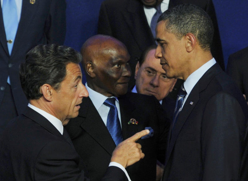 French President Nicolas Sarkozy, left, gestures toward US President Barack Obama during a group photo at the G8 summit in Deauville, France, Friday, May 27, 2011. G8 leaders, in a two-day meeting, will discuss the Internet, aid for North African states and ways in which to end the conflict in Libya. (AP Photo/Philippe Wojazer, Pool)