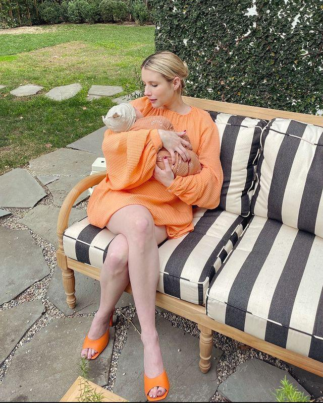 """<p>Sharing the news on Instagram, the Scream Queens actor wrote that 2020 'got one right thing right' in the birth of her son, Rhodes Robert Hedlund.</p><p>The actor, who wore an orange Stella McCartney dress in the picture, paired with orange shoes by Andrea Wazen, matched with her son who had been dressed in an adorable orange babygrow. </p><p>This is the first child for Roberts and her partner Garrett Hedlund,<br></p><p><a href=""""https://www.instagram.com/p/CJ9tiLwgT7T/"""" rel=""""nofollow noopener"""" target=""""_blank"""" data-ylk=""""slk:See the original post on Instagram"""" class=""""link rapid-noclick-resp"""">See the original post on Instagram</a></p>"""