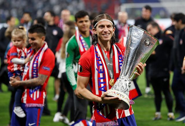 Soccer Football - Europa League Final - Olympique de Marseille vs Atletico Madrid - Groupama Stadium, Lyon, France - May 16, 2018 Atletico Madrid's Filipe Luis celebrates with the trophy after winning the Europa League REUTERS/Gonzalo Fuentes