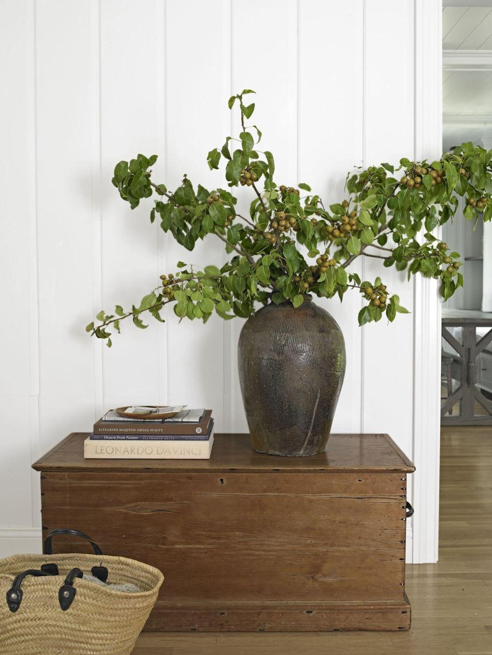 """<p>""""Cut or buy these beautiful branches long,"""" Liza Lubell of Brooklyn's Peartree Flowers says, then balance their heft with an equally sizable container. Start by placing your tallest cuttings in the middle, and fan out with the shorter ones from there. An ideal home for such a striking setup: a low piece of furniture, like a chest or bench. You can also try olives or forsythia.</p><p><a class=""""link rapid-noclick-resp"""" href=""""https://www.amazon.com/Chinese-Shingo-Artificial-Lifelike-Simulation/dp/B01LFACDIA?tag=syn-yahoo-20&ascsubtag=%5Bartid%7C10050.g.1371%5Bsrc%7Cyahoo-us"""" rel=""""nofollow noopener"""" target=""""_blank"""" data-ylk=""""slk:SHOP FAUX PEARS"""">SHOP FAUX PEARS</a></p>"""