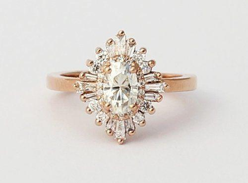 """<i>Buy it from <a href=""""http://www.heidigibson.com/designs/the-oval-gatsby-petite"""" target=""""_blank"""">Heidi Gibson</a> for $2,100.</i>"""