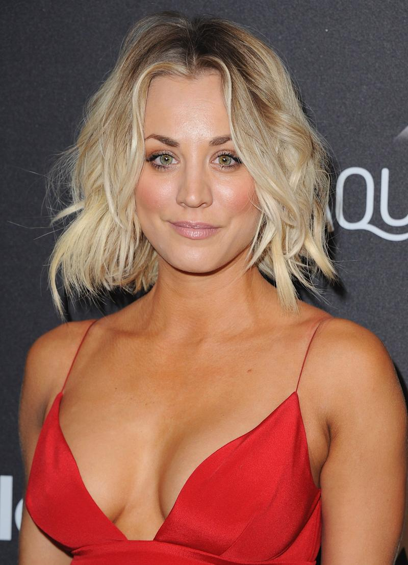 Kaley Cuoco poses in a red dress