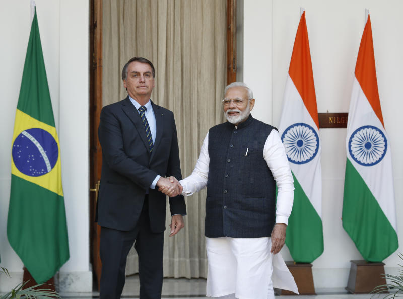 Indian Prime Minister Narendra Modi, right, shakes hand with Brazil's President Jair Bolsonaro before their delegation level meeting in New Delhi, India, Saturday, Jan. 25, 2020. Bolsonaro is this year's chief guest for India's Republic day parade. (AP Photo/Manish Swarup)