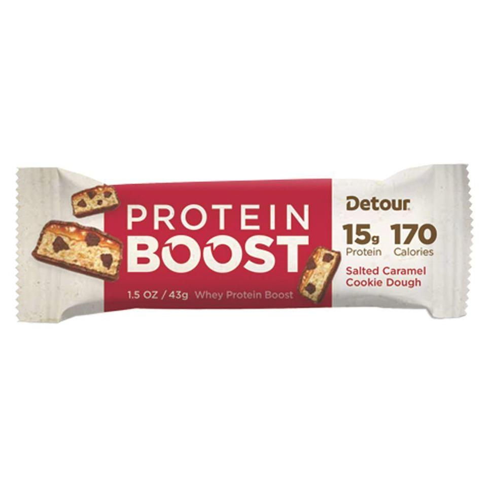 """<p><strong>Detour</strong></p><p>detourbar.com</p><p><a href=""""https://www.detourbar.com/products/salted-caramel-cookie-dough?variant=12232195637319"""" rel=""""nofollow noopener"""" target=""""_blank"""" data-ylk=""""slk:BUY NOW"""" class=""""link rapid-noclick-resp"""">BUY NOW</a></p><p>Cookie dough is a stacked flavor category for protein bars, but the salted caramel adds an interesting jolt to regular old sweetness. You'll net 20 grams of protein and six grams of fiber for 230 calories. This is the protein bar for people who don't like the flavor of most protein bars.</p>"""