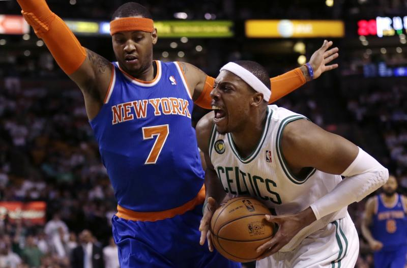 Boston Celtics forward Paul Pierce, right, yells as he tries to drive past New York Knicks forward Carmelo Anthony (7) during the first quarter in Game 6 of their first-round NBA basketball playoff series in Boston, Friday, May 3, 2013. (AP Photo/Charles Krupa)