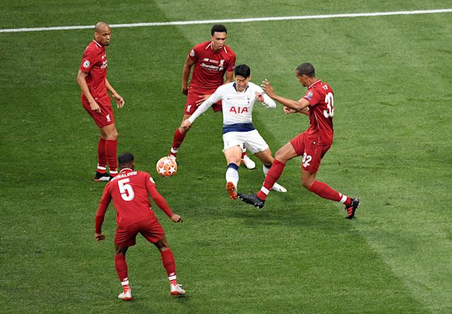 Heung-Min Son of Tottenham Hotspur is crowded out by Joel Matip (r), Trent Alexander-Arnold (c), Fabinho (c) and Georginio Wijnaldum (bottom) (Photo by David Ramos/Getty Images)