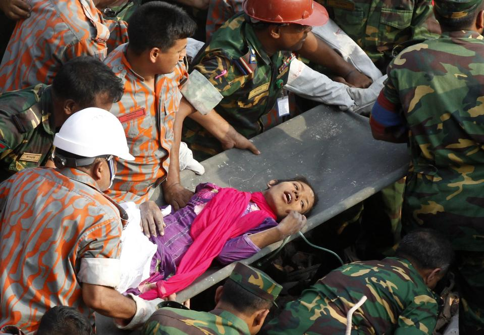 FILE - In this Friday, May 10, 2013 file photo, Reshma Begum lies on a stretcher after being pulled out from the rubble of a garment factory building that collapsed in Saver, near Dhaka, Bangladesh. For 17 days, Begum survived under heaps of rubble after the eight-story factory collapsed in Bangladesh eight years ago. Stories of endurance and longevity under the most dire circumstances continue to kindle hopes that rescuers will find more people alive within the tons of debris that was once the 12-story Champlain Tower condos Surfside, Fla. (AP Photo/Hasan Raza)
