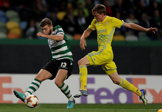 Soccer Football - Europa League Round of 32 Second Leg - Sporting CP vs Astana - Estadio Jose Alvalade, Lisbon, Portugal - February 22, 2018 Sporting's Stefan Ristovski in action with Astana's Marin Tomasov REUTERS/Rafael Marchante