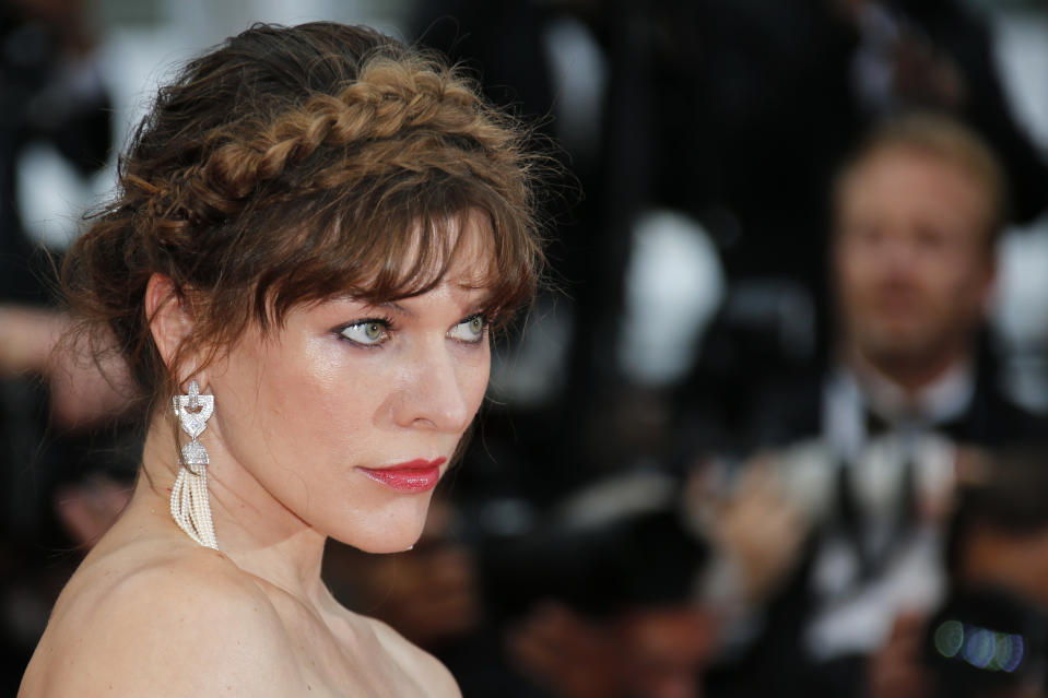 "72nd Cannes Film Festival - Screening of the ""Sibyl"" in competition - Red Carpet Arrivals - Cannes, France, May 24, 2019. Milla Jovovich poses. REUTERS/Jean-Paul Pelissier"