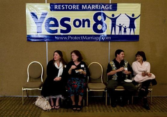 "(L-R) Vivi Morris, Mary Morris, Alex Case and Ninie Case talk under a ""Yes on 8'' sign at a pro Proposition 8 election party in Irvine, California November 4, 2008."