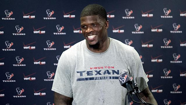 Houston Texans wide receiver Andre Johnson smiles while answering a question after reporting for NFL football training camp Friday, July 25, 2014, in Houston. The Texans begin practices Saturday. (AP Photo/David J. Phillip)