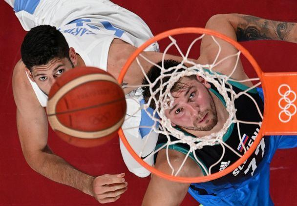 PHOTO: Luka Doncic of Slovenia positions for a rebound against Patricio Garino of Argentina in the group round of men's basketball on July, 26, 2021. (Aris Messinis/Pool via Reuters)