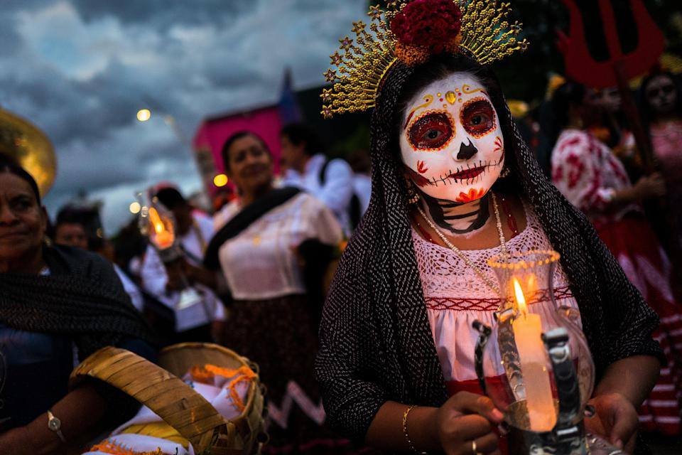 Mexico's Day of the Dead celebrations will look different this year, as the country has called on cemeteries to close to the public in an effort to curb coronavirus infections. (Getty Images)