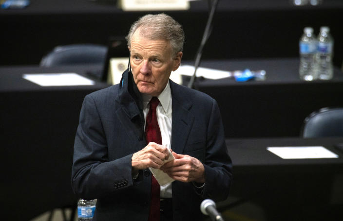 FILE - In this Jan. 8, 2021, file photo, Illinois House Speaker Michael Madigan appears on the floor as the Illinois House of Representatives convenes at the Bank of Springfield Center, in Springfield, Ill. Madigan, the Chicago Democrat who virtually set Illinois' political agenda as House speaker before he was ousted last month, resigned his seat Thursday, Feb. 18, 2021. Madigan marked 50 years as a state representative in January. (E. Jason Wambsgans/Chicago Tribune via AP, File)