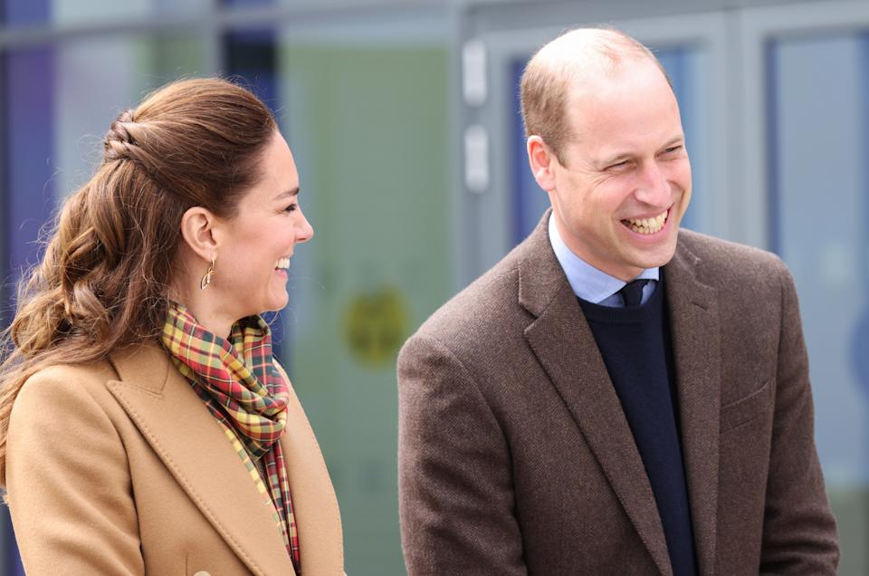 KIRKWALL, SCOTLAND - MAY 25: Prince William, Duke of Cambridge and Catherine, Duchess of Cambridge laugh as they officially open The Balfour, Orkney Hospital on day five of their week long visit to Scotland on May 25, 2021 in Kirkwall, Scotland. Recently opened in 2019, The Balfour replaced the old hospital, which had served the community for ninety years. The new facility has enabled the repatriation of many NHS services from the Scottish mainland, allowing Orkney's population to receive most of their healthcare at home. The new building's circular design is based on the 5000-year-old Neolithic settlement, Skara Brae, making it a unique reflection of the local landscape in which many historical sites are circles. (Photo by Chris Jackson - WPA Pool/Getty Images)