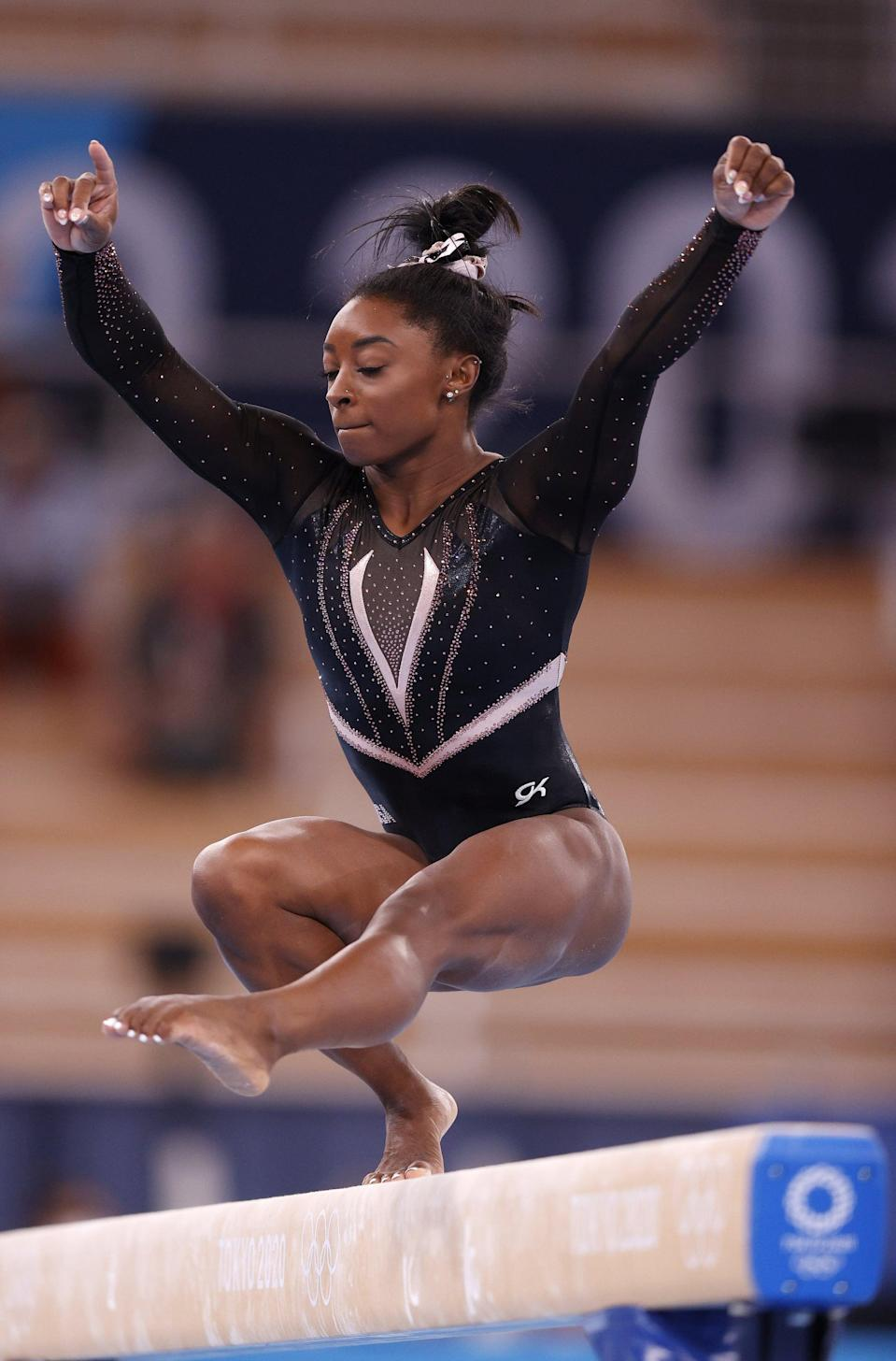<p>Here you can see the front of the black leotard worn by Team USA at the Tokyo Olympics during podium training. The <span>GK version</span> ($90) inspired by it is sleeveless and just as bold, beautiful, and sparkly. </p>