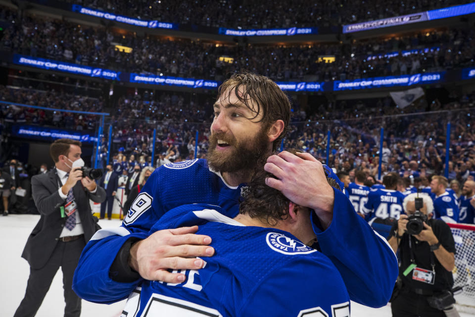 TAMPA, FL - JULY 7: Barclay Goodrow #19 and Yanni Gourde #37 of the Tampa Bay Lightning celebrate winning the Stanley Cup after defeating the Montreal Canadiens in Game Five to win the best of seven game series 4-1 during the Stanley Cup Final of the 2021 Stanley Cup Playoffs at Amalie Arena on July 7, 2021 in Tampa, Florida. (Photo by Scott Audette/NHLI via Getty Images)