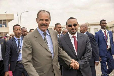 Eritrean President Isaias Afwerki and Ethiopia's Prime Minister Abiy Ahmed and walk together at Asmara International Airport