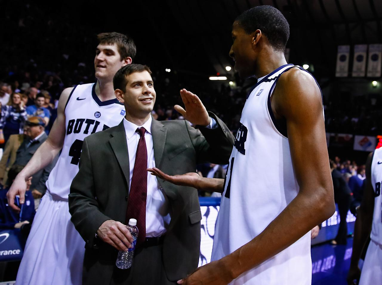 INDIANAPOLIS, IN - MARCH 09: Head coach Brad Stevens of the Butler Bulldogs congratulates Kameron Woods #31 of the Butler Bulldogs following the game against the Xavier Musketeers at Hinkle Fieldhouse on March 9, 2013 in Indianapolis, Indiana. Butler defeated Xavier 67-62. (Photo by Michael Hickey/Getty Images)