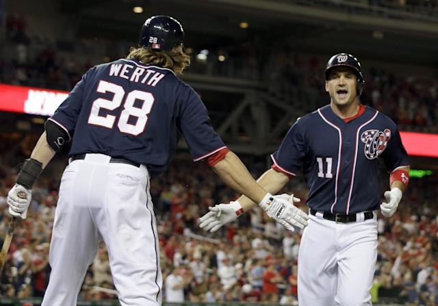 Washington Nationals' Ryan Zimmerman (11) celebrates his solo home run with Jayson Werth (28) during the third inning of a baseball game against the Philadelphia Phillies at Nationals Park, Friday, Sept. 13, 2013, in Washington. (AP Photo/Alex Brandon)
