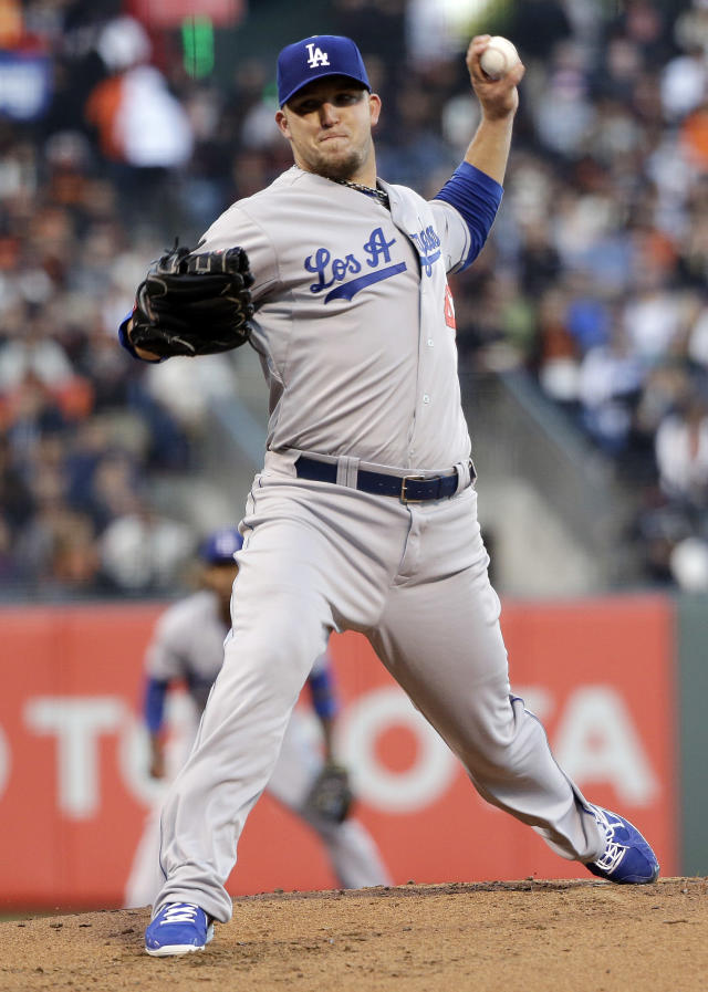 Los Angeles Dodgers starter Paul Maholm throws to the San Francisco Giants during the first inning of a baseball game Wednesday, April 16, 2014, in San Francisco. (AP Photo/Marcio Jose Sanchez)