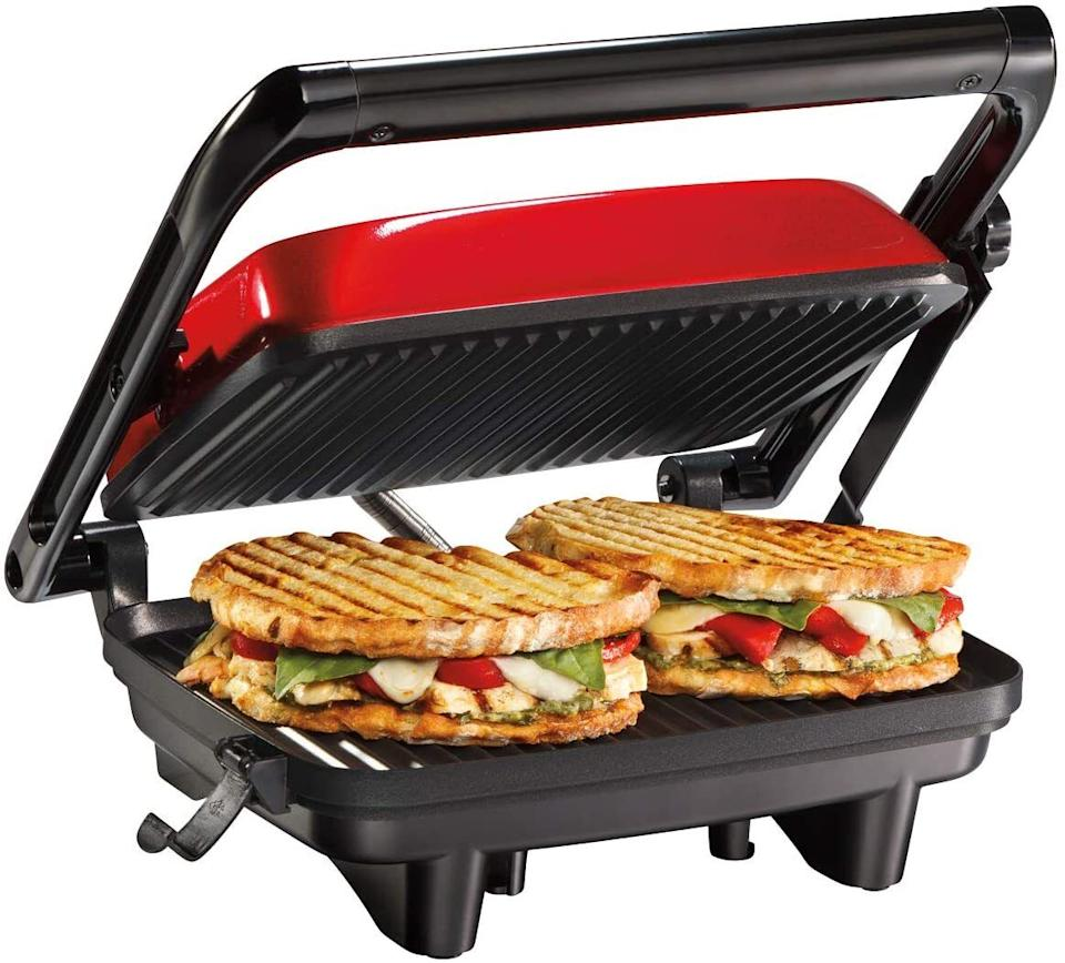"""Now yourleftovers can easily be turned into delicious pressed sandwiches!<br /><br /><strong>Get it from Amazon for <a href=""""https://www.amazon.com/Hamilton-Beach-25462Z-Gourmet-Sandwich/dp/B00E134JJ0?&linkCode=ll1&tag=huffpost-bfsyndication-20&linkId=473af3f993c2017e94840e233a382683&language=en_US&ref_=as_li_ss_tl"""" target=""""_blank"""" rel=""""noopener noreferrer"""">$27.84</a> (available in three colors).</strong>"""