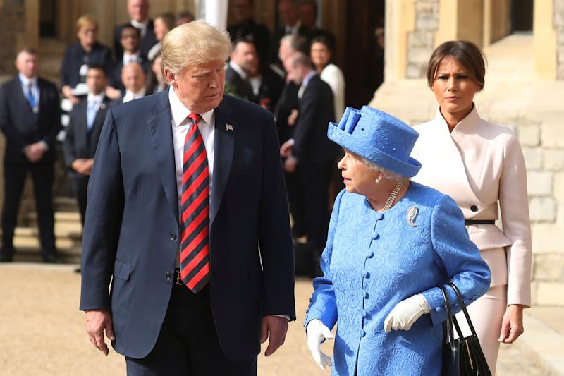 Britain's Queen Elizabeth II, right, US President of the United States, Donald Trump and first lady Melania walk from the Quadrangle after inspecting the Guard of Honour, during the president's visit to Windsor Castle, Friday, July 13, 2018 in Windsor, England. The monarch welcomed the American president in the courtyard of the royal castle. (Chris Jackson/Pool Photo via AP)