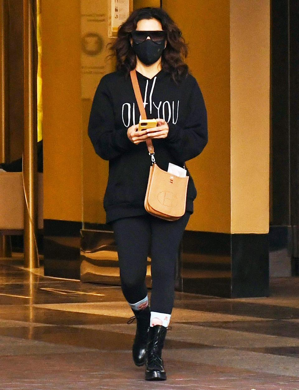 <p>Eva Longoria bundles up in a black sweatshirt, pants and boots while out on Monday in L.A.</p>