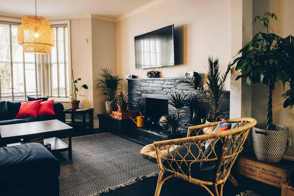 """<p>This sleek Airbnb in Cornwall is one for a stylish trip to Newquay with your gang - whether you plan on surfing or simply relaxing at the beach. The stylish four-bedroom townhouse offers a modern twist on the traditional, with its blend of classic and Scandi decor. </p><p>It's just one minute from the beach, making it a great spot for families or a group of friends. It's also dog friendly and you'll find a few terrific touches, such as the Nespresso machine, private decking for alfresco dining and a lounge and dining area for socialising with the fam.</p><p><strong>Sleeps</strong>: 10</p><p><strong>Price per night:</strong> £380</p><p><strong>Why we love it:</strong> It's a real home away from home for big groups with spaces that encourage you to spend time with your loved ones - we're particularly into the outside decking area.</p><p><a class=""""link rapid-noclick-resp"""" href=""""https://www.airbnb.co.uk/rooms/22044933"""" rel=""""nofollow noopener"""" target=""""_blank"""" data-ylk=""""slk:SEE INSIDE"""">SEE INSIDE</a></p>"""