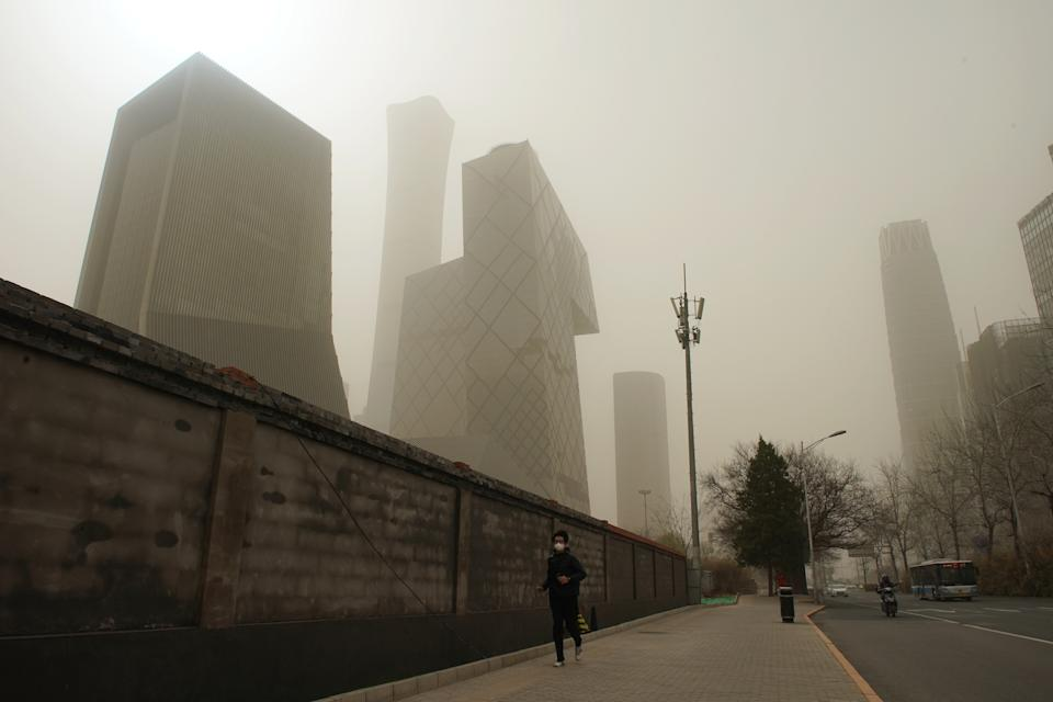BEIJING, March 28, 2021 -- A man walks on a road in Beijing, capital of China, March 28, 2021. (Photo by Ju Huanzong/Xinhua via Getty) (Xinhua/Ju Huanzong via Getty Images)