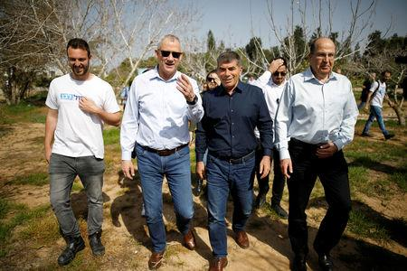 FILE PHOTO: Benny Gantz, head of the Blue and White party, walks with fellow party candidates during a visit to a kibbutz in Israel outside the northern Gaza Strip, March 13, 2019. REUTERS/Amir Cohen/File Photo
