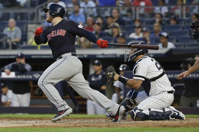 Cleveland Indians' Roberto Perez watches his two-run home run, next to New York Yankees catcher Gary Sanchez during the first inning of a baseball game Thursday, Aug. 15, 2019, in New York. (AP Photo/Frank Franklin II)