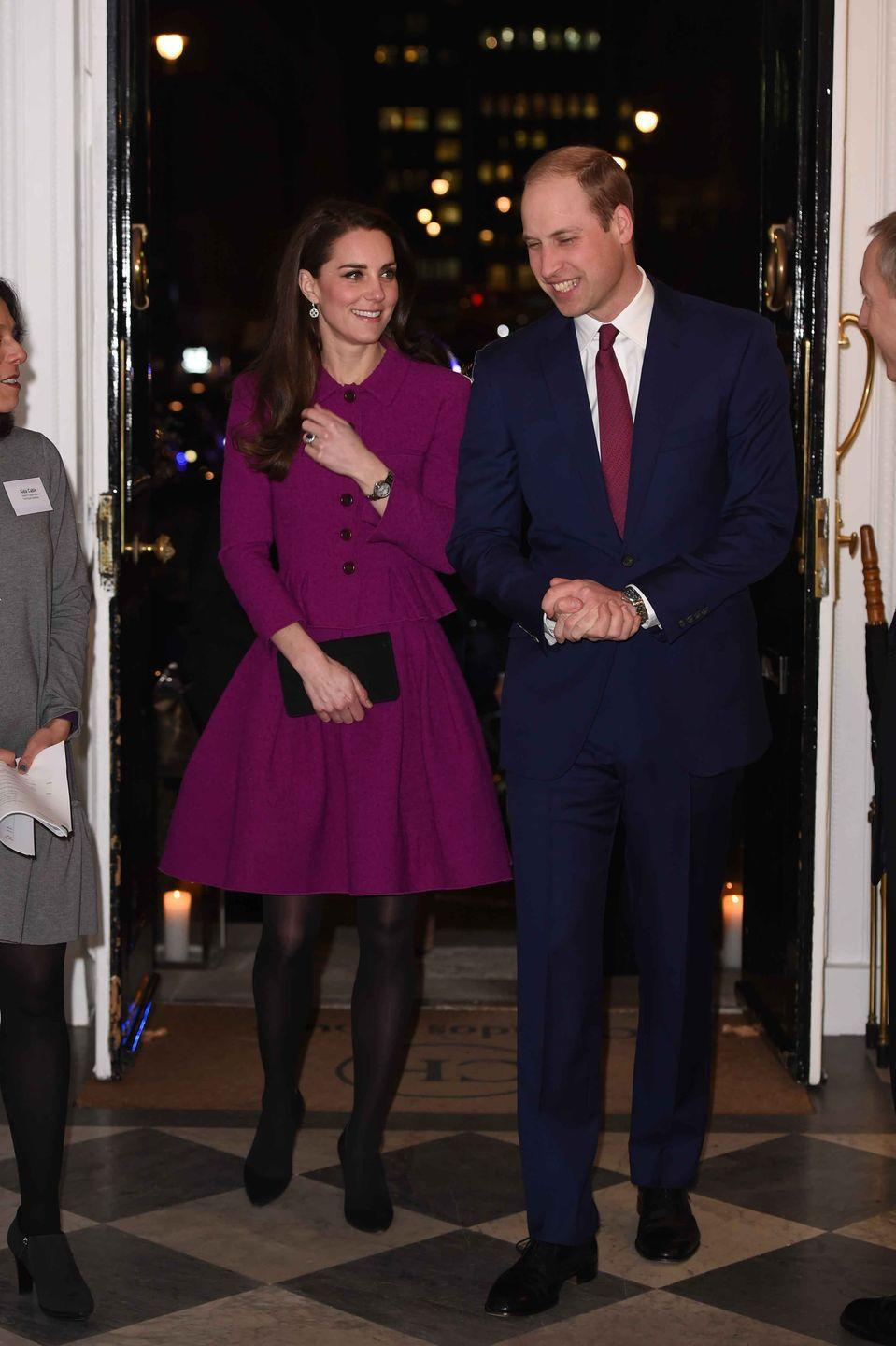 <p>Kate wears a purple Oscar de la Renta ensemble with black tights, pumps, and clutch to the Guild of Health Writers Conference with Prince William.</p>