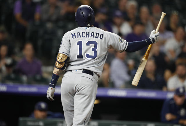 San Diego Padres' Manny Machado reacts after striking out against Colorado Rockies relief pitcher Carlos Estevez during the eighth inning of a baseball game Friday, Sept. 13, 2019, in Denver. (AP Photo/David Zalubowski)