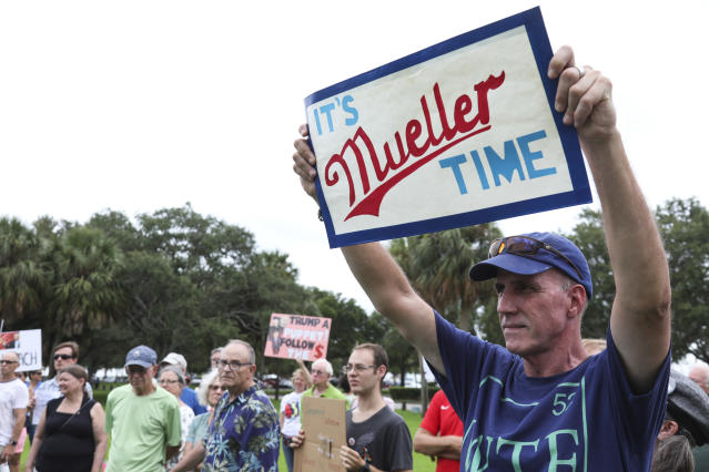 "<p>Daniel Quinn of St. Petersburg holds up a sign with the phrase ""It's Mueller Time"" during a rally at Demens Landing in St. Petersburg, Fla., on July 18, 2018. (Photo: Eve Edelheit/Tampa Bay Times via AP) </p>"