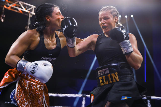 Elin Cederroos, right, throws a right against Alicia Napoleon-Espinosa during the 10th round of their boxing bout in Atlantic City, N.J., Friday, Jan. 10, 2020. (AP Photo/Matt Rourke)