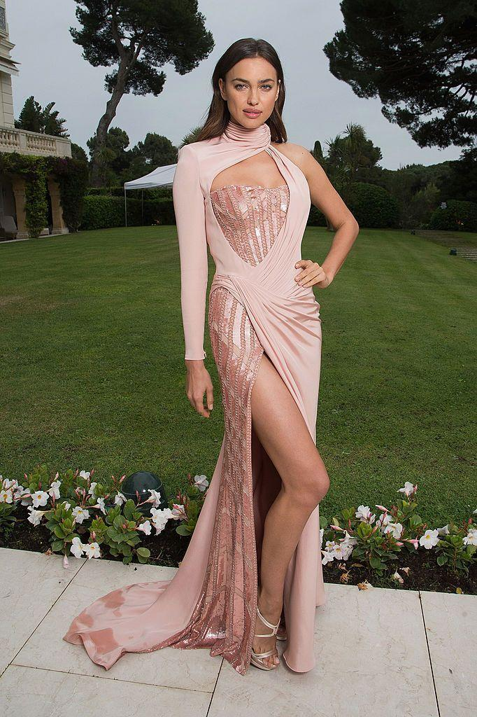 <p>Shayk wore an asymmetric Versace gown in Cannes.</p>