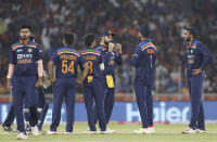 India's captain Virat Kohli, center, celebrates the dismissal of England's Jason Roy during the first Twenty20 cricket match between India and England in Ahmedabad, India, Friday, March 12, 2021. (AP Photo/Aijaz Rahi)