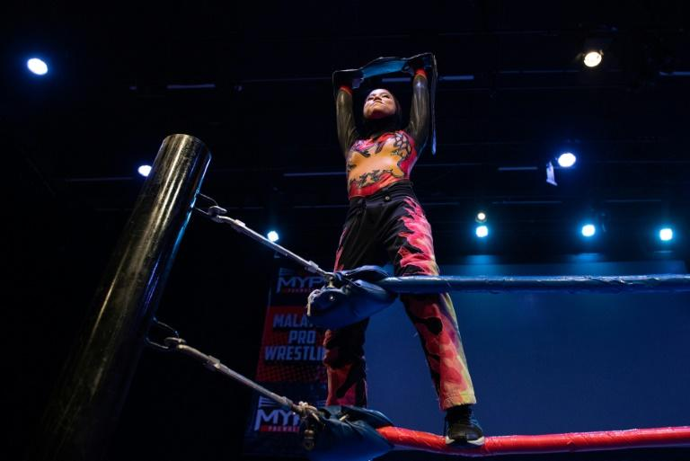 A hijab-wearing, diminutive Malaysian wrestler cuts an unusual figure in the ring, a female Muslim fighter taking on hulking opponents in a male-dominated world