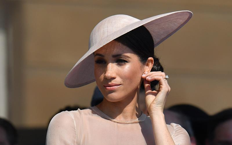 Britain's Meghan, Duchess of Sussex, attends the Prince of Wales's 70th Birthday Garden Party at Buckingham Palace in London on May 22, 2018. - The Prince of Wales and The Duchess of Cornwall hosted a Garden Party to celebrate the work of The Prince's Charities in the year of Prince Charles's 70th Birthday. (Photo by Dominic Lipinski / POOL / AFP) (Photo credit should read DOMINIC LIPINSKI/AFP via Getty Images)