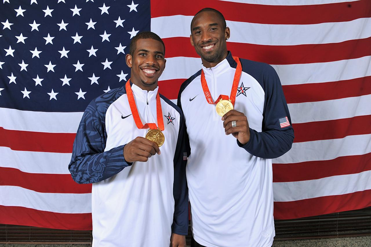 BEIJING - AUGUST 24:  (L-R) Chris Paul #13 and Kobe Bryant #10 of the United States pose with their gold medals after winning the men's gold medal at the 2008 Beijing Olympic Games against Spain at the Beijing Olympic Basketball Gymnasium on August 24, 2008 in Beijing, China. The United States defeated Spain 118-107 to take the men's gold medal. NOTE TO USER: User expressly acknowledges and agrees that, by downloading and/or using this Photograph, user is consenting to the terms and conditions of the Getty Images License Agreement. Mandatory Copyright Notice: Copyright 2008 NBAE (Photo by Jesse D. Garrabrant/NBAE via Getty Images)