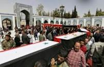 Mass funeral for dozens killed in attack on evacuees
